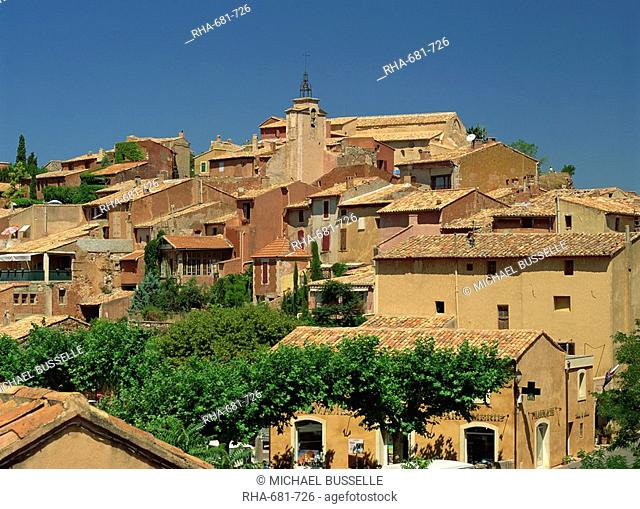 Houses and church tower on the skyline in the village of Roussillon, Vaucluse, Provence, France, Europe