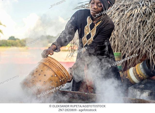 People prepare anchovies, locally called Dagaa, for drying at Mkokotoni village, Zanzibar. Local people use dagaa for preparing food as itâ