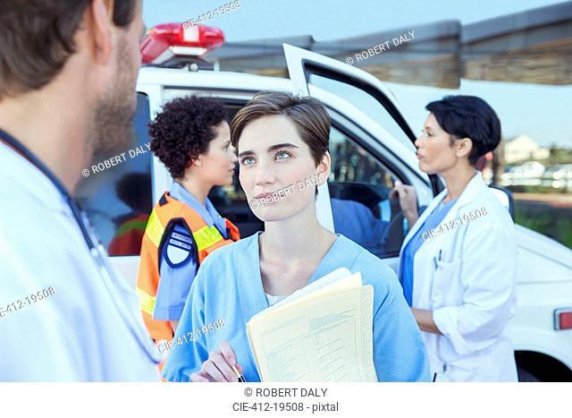 Doctor and nurse talking outside hospital