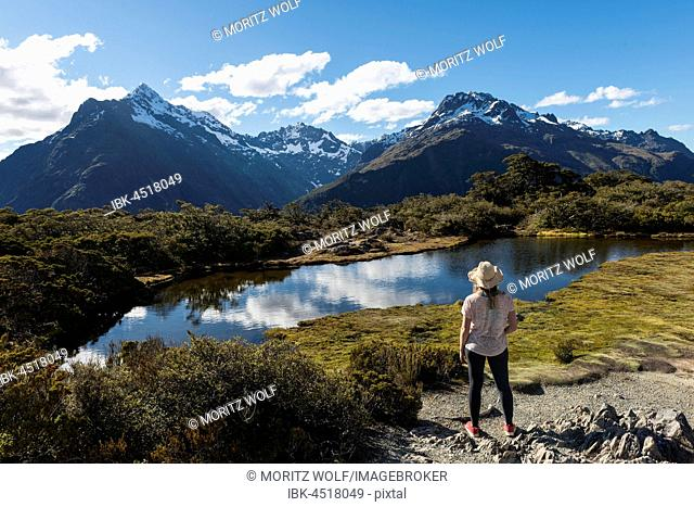Hiker, Little Mountain Lake, Mount Christina Mountains, Mount Crosscut, Mount Lyttle, Key Summit Track, Fiordland National Park, Southland Region, New Zealand