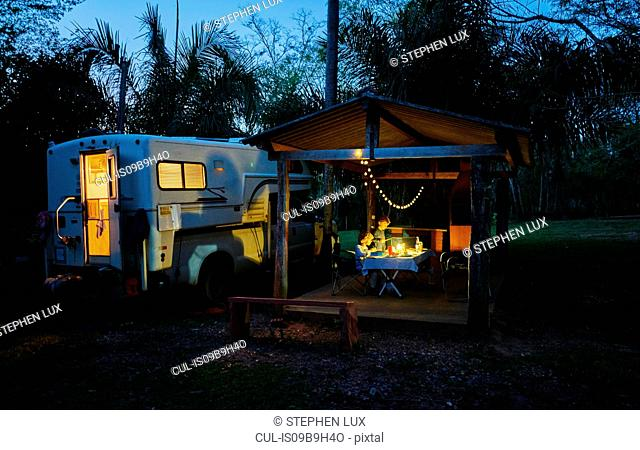 Campervan parked on campsite by picnic shelter at night, Bonito, Mato Grosso do Sul, Brazil, South America