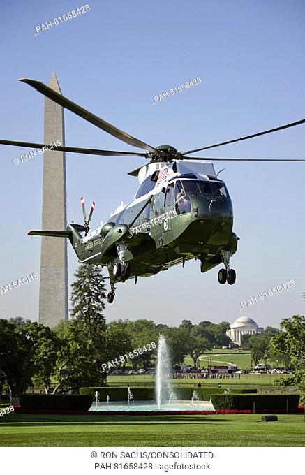 Summer morning view of Marine One as it prepares to land on the South Lawn of the White House to pick-up United States President Barack Obama who will depart to...