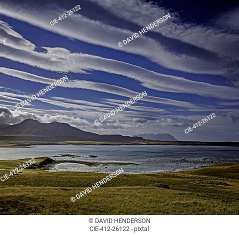 Clouds forming lines over lake and mountain landscape, Snaefellsnes, Iceland
