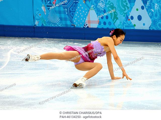 Mao Asada of Japan falls during the Figure Skating team event at Iceberg Skating Palace during the Sochi 2014 Olympic Games, Sochi, Russia, 08 February 2014