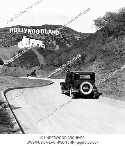 Hollywood, Los Angeles:Ê c. 1924.A sign advertises the opening of the Hollywoodland housing development in the hills on Mulholland Drive overlooking Los Angeles