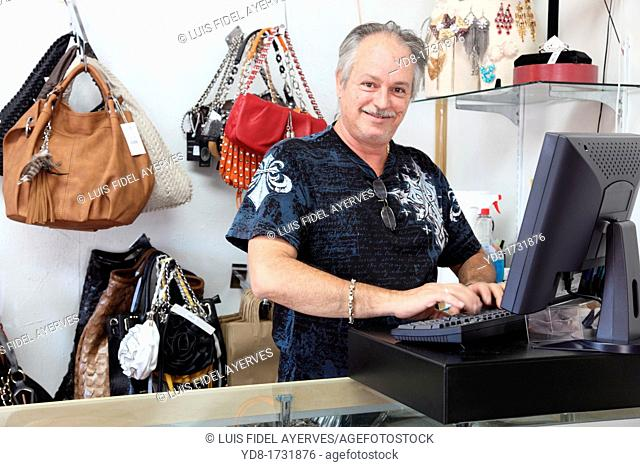 Owner of shop happy handbags and shoes that had a good day, Miami Beach, Florida, USA
