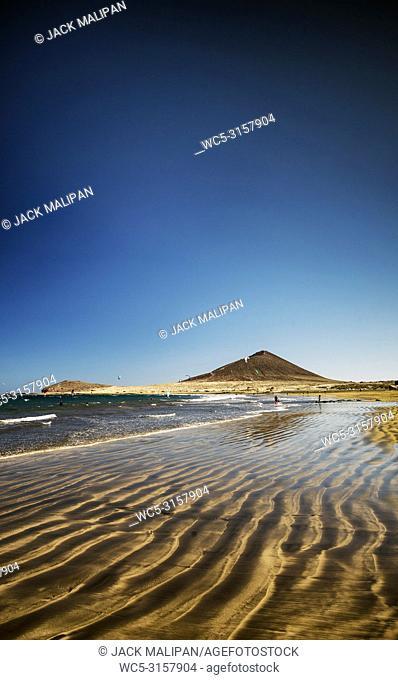 el medano surfing beach and montana roja landmark in south tenerife spain