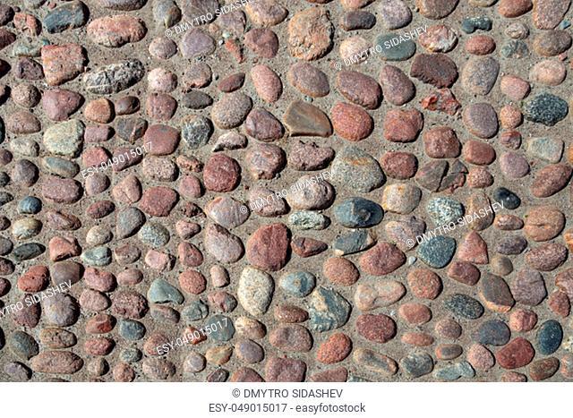Stone pavement texture background. Cobblestone background. Stone pavement texture