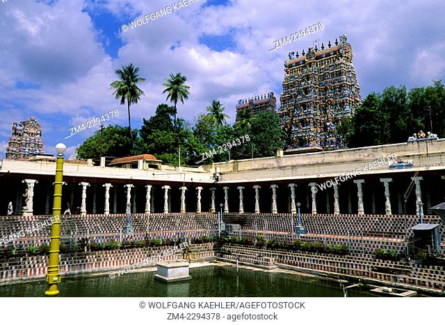 Courtyard with pool of the Meenakshi Amman Temple, which is a historic Hindu temple built in 1560 and located on the southern bank of the Vaigai River in the...