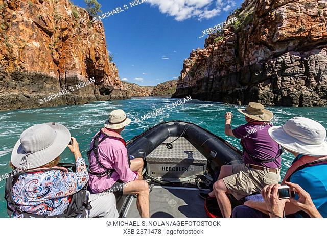 Lindblad Expeditions guest on a Zodiac cruise at the Horizontal Waterfalls, Talbot Bay, Kimberley, Western Australia, Australia