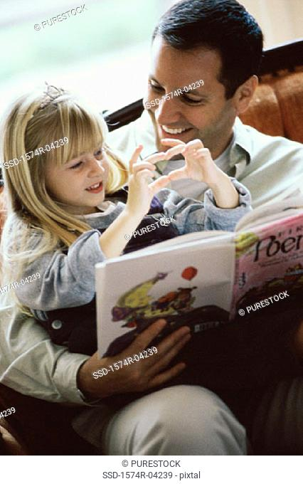 Girl playing with her father