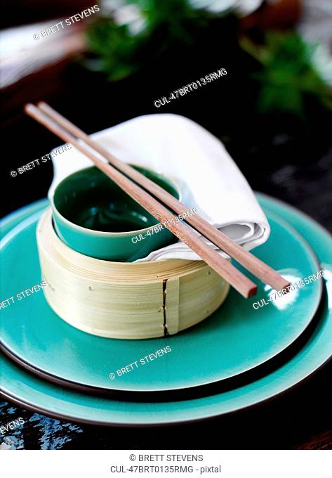 Bowl and chopsticks on rice steamer