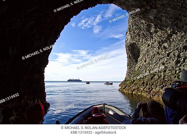 Zodiac cruising among columnar basalt in Hvalvík Bay on the northern coast of Iceland  MORE INFO Hvalvík Bay exhibits classic columnar basalt formations and is...