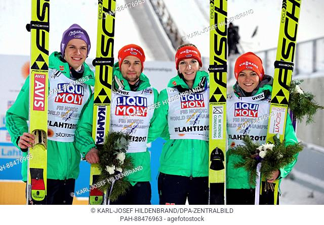 L-R: Andreas Wellinger, Markus Eisenbichler, Svenja Würth and Carina Vogt from Germany celebrate at the Nordic World Ski Championships in Lahti, Finland