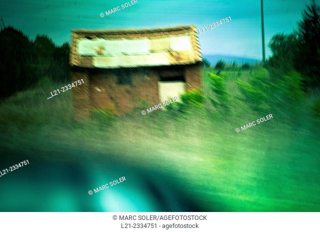 Travelling through Roussillon. Vineyard and house in movement. Roussillon, France