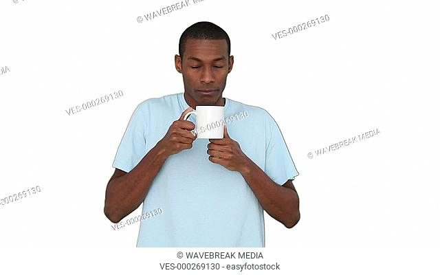 Casual young man enjoying cup of coffee