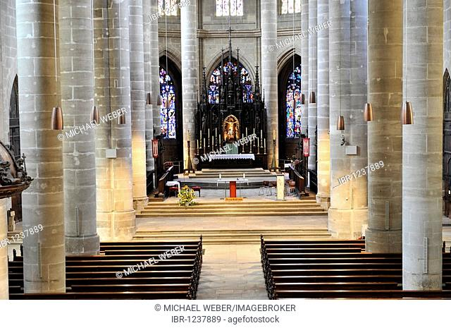 Interior of nave and neogothic high altar in the choir room with apse chapels, Heilig-Kreuz-Muenster Holy Cross cathedral, South German hall Gothic