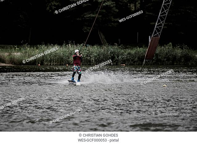 Germany, Garbsen, wakeboarder at Blue Lake