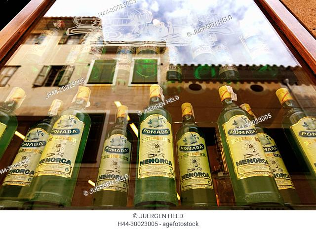 Spain Menorca Mahon old city center . Pomada Xoriguer Gin in shop windows, reflections