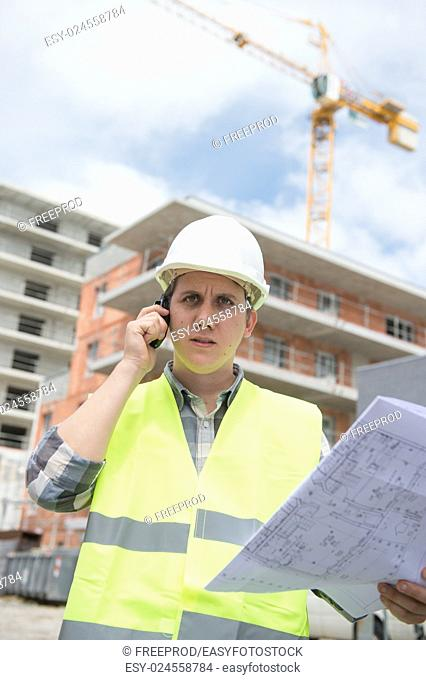 Construction manager checking construction building project on site