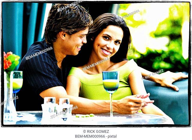 Hispanic couple having lunch together