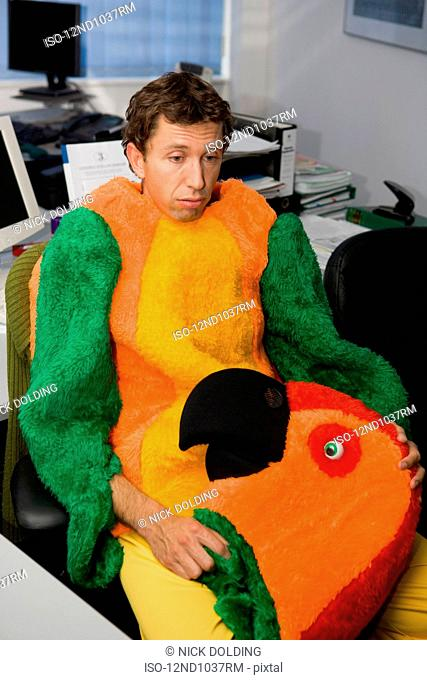 Man in office dressed in parrot suit