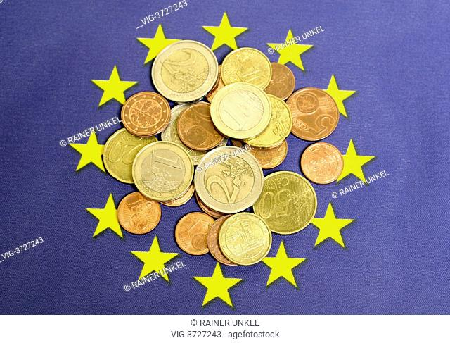 GERMANY, BONN, 31.05.2013, Euro coins on a EU-Flag - Bonn, Northrhine-, Germany, 31/05/2013