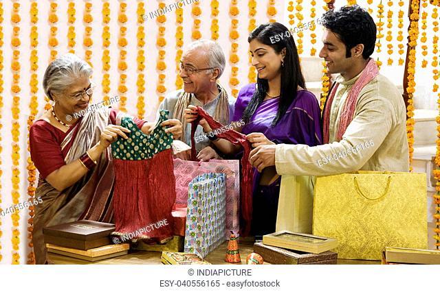 Family looking at diwali gifts