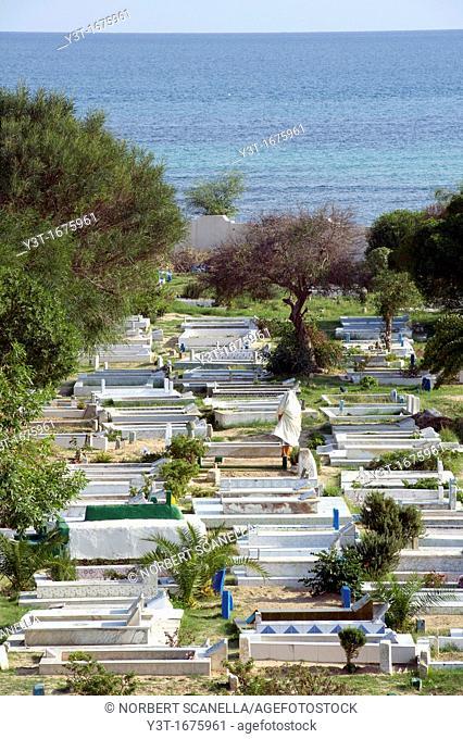 North Africa, Tunisia, Cape Bon, Hammamet. Woman in a Muslim cemetery