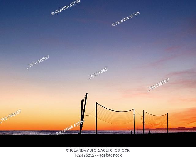 Installing beach volleyball, a winter sunset