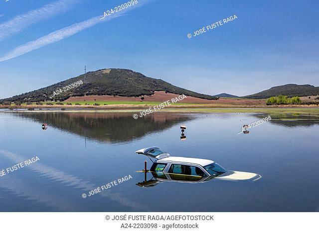 Spain , Castilla La Mancha Region, Ciudad Real Province, car in lake