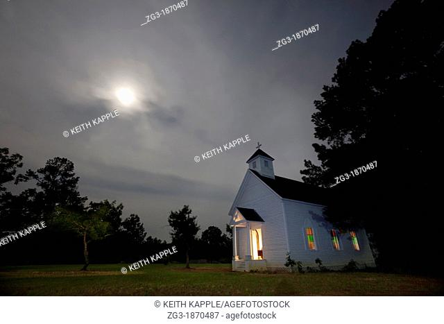 Abandoned Old Church at night, with moon glow halo, Rusk, Texas
