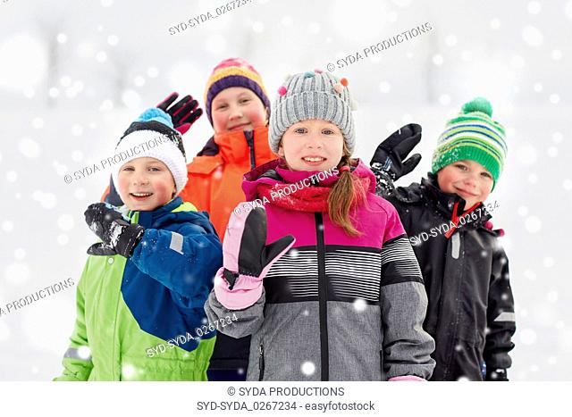 happy little kids in winter clothes outdoors