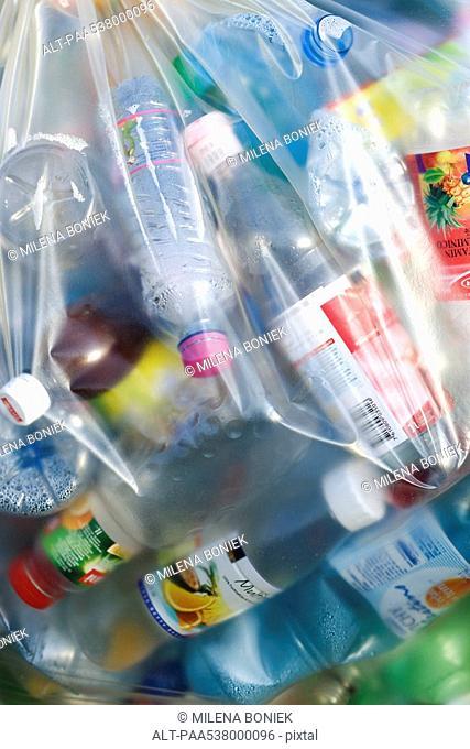 Plastic bag full of plastic bottles, full frame