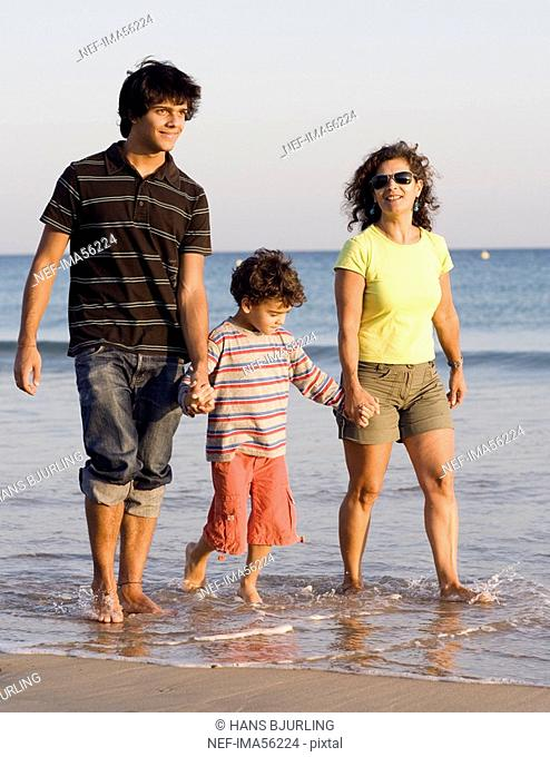 A family walking by the sea Portugal