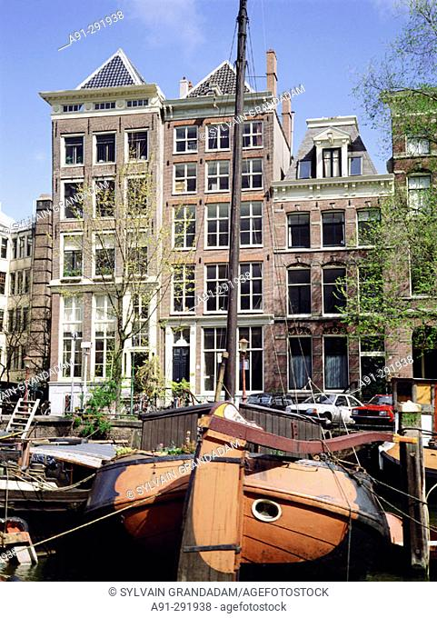 Old boats moored in canal. Amsterdam. Holland