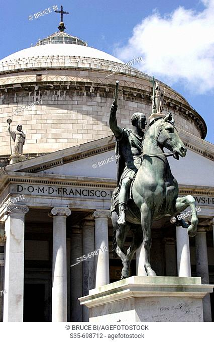 The equestrian bronze statue of Charles III of Borbone in front of Church of San Francesco di Paola on the Piazza del Plebiscito. Naples. Campania