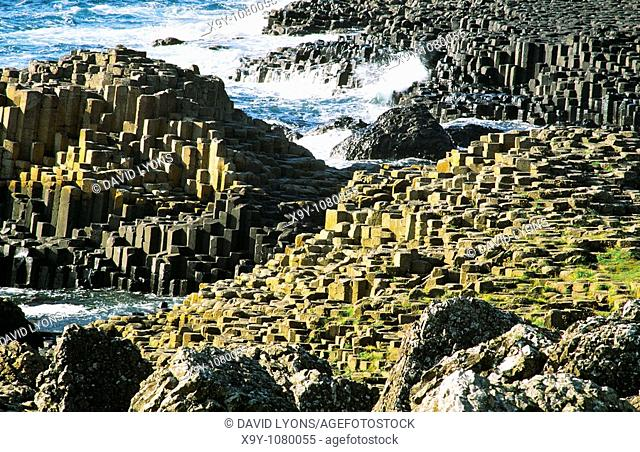 The Giants Causeway near Bushmills, Ireland  Volcanic basalt rock hexagonal columns of the Honeycomb and the Grand Causeway