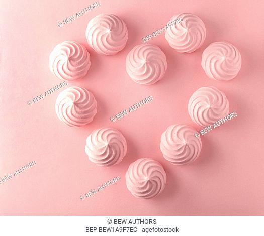 Pink meringues. Idea of background