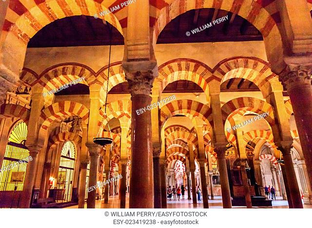Arches Pillars Mezquita Cordoba Spain. Created in 785 as a Mosque, was converted to a Cathedral in the 1500. 850 Columns and Arches