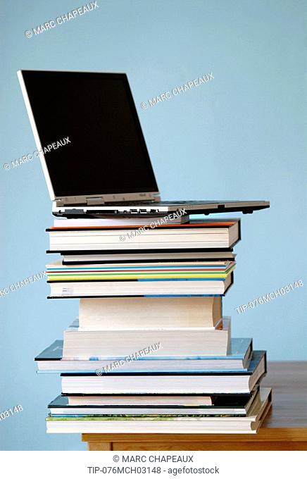 Laptop on pile of books