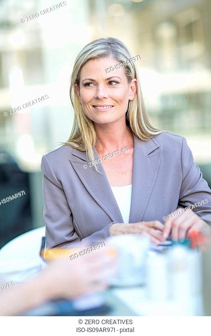 Businesswoman at coffee break on hotel terrace