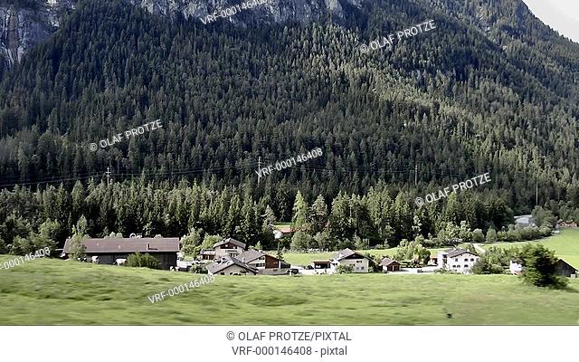 Train ride in the Glacier Express through a Swiss landscape