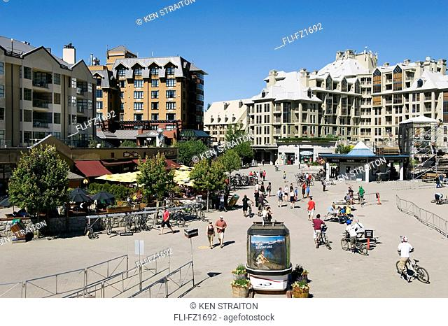 Skiers Plaza in summer with mountain bikers, Whistler Village, Whistler, British Columbia