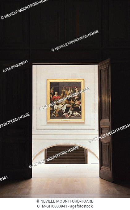 Painting visible through doorway of the Louvre Museum in Paris