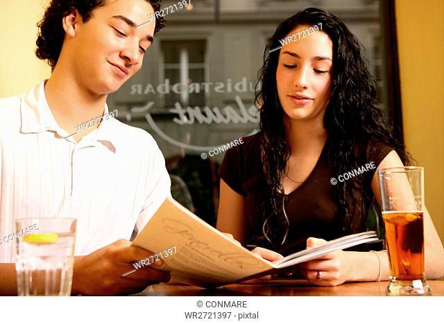 teenage couple, girl, boy, restaurant, menu, teens