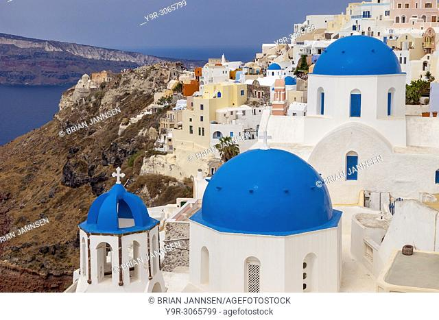 Colored church domes and buildings of Oia on the island of Santorini, The Cyclades, Greece