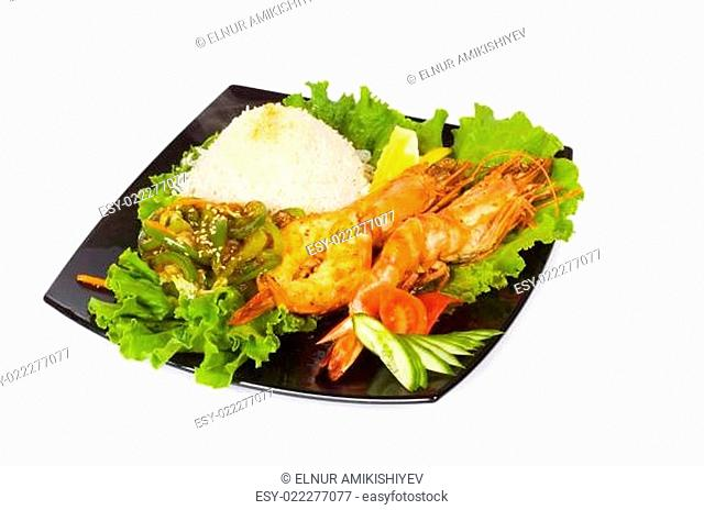 Grilled lobster, rice and vegetables isolated on white