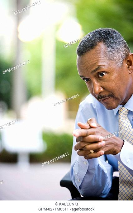 Close up of African American businessman sitting outside
