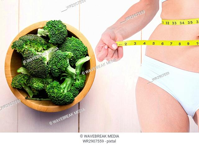 Composite image of woman and vegetables